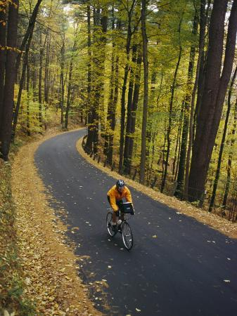 skip-brown-a-cyclist-riding-along-a-rural-road-in-the-fall