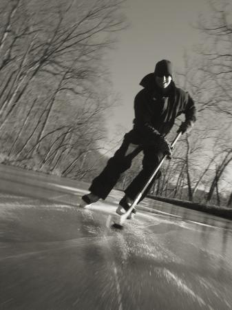 skip-brown-ice-skater-with-a-hockey-stick-on-the-frozen-c-and-o-canal