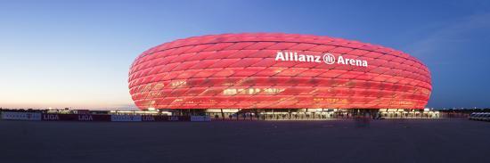 soccer-stadium-lit-up-at-dusk-allianz-arena-munich-bavaria-germany