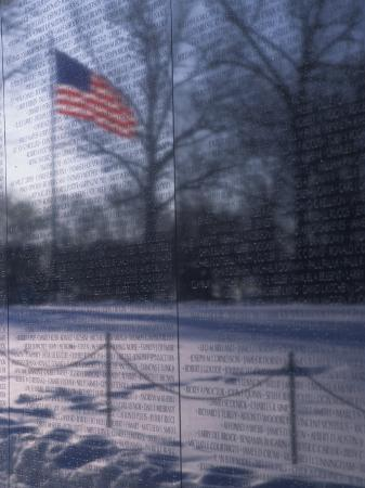 stacy-gold-american-flag-reflected-in-the-vietnam-memorial-washington-d-c
