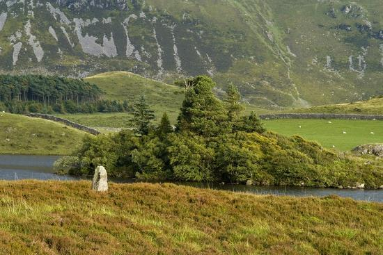 standing-stone-in-welsh-upland-mountain-landscape-on-lake-edge