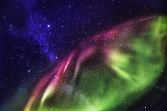 starry-evening-with-the-aurora-borealis-or-northern-lights-and-the-milky-way-galaxy-abisko