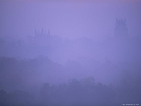 stephen-alvarez-chapel-towers-rise-out-of-blue-fog-at-dawn