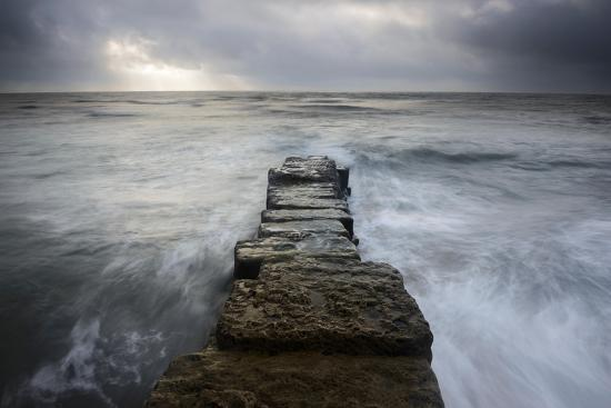 stephen-spraggon-a-wall-leading-into-the-sea-at-lyme-regis-dorset