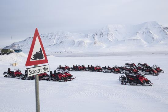 stephen-studd-snow-mobile-traffic-sign-in-front-of-snow-mobiles