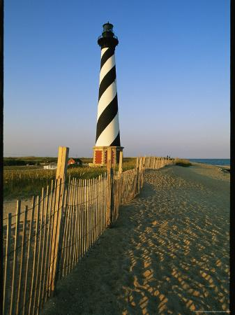 steve-winter-cape-hatteras-lighthouse-with-surrounding-sand-fence