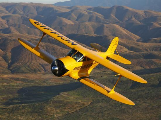 stocktrek-images-a-beechcraft-d-17-staggerwing-in-flight
