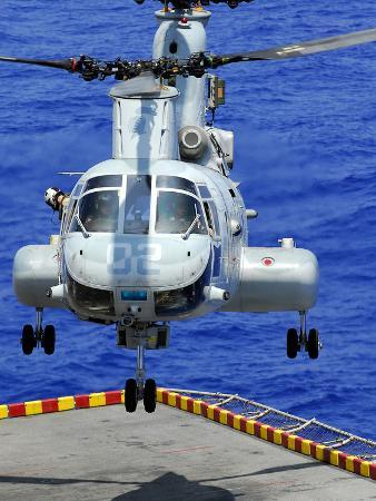 stocktrek-images-a-ch-46e-sea-knight-helicopter-prepares-to-land-on-the-flight-deck-of-uss-peleliu