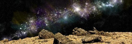 stocktrek-images-a-colorful-nebula-above-a-rocky-and-barren-alien-world