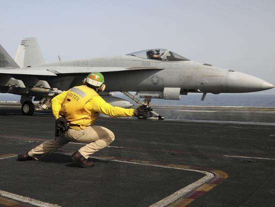 stocktrek-images-a-shooter-launches-an-f-a-18e-super-hornet-from-uss-dwight-d-eisenhower