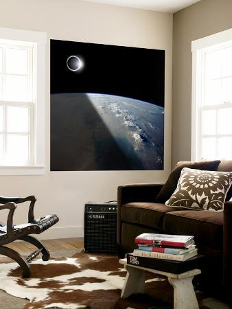 stocktrek-images-a-solar-eclipses-partially-shades-the-earth-below
