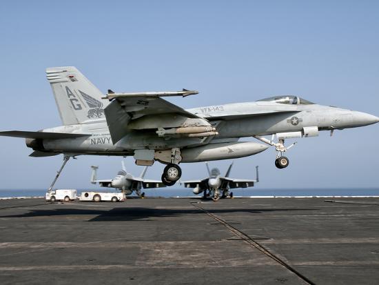 stocktrek-images-a-us-navy-f-a-18e-super-hornet-prepares-to-land-aboard-uss-eisenhower
