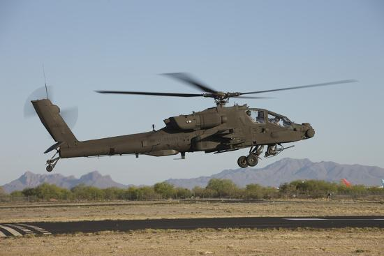 stocktrek-images-ah-64d-apache-longbow-lifts-off-on-a-mission