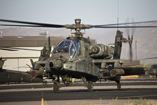 stocktrek-images-ah-64d-apache-longbow-taxiing-out-to-the-launch-pad
