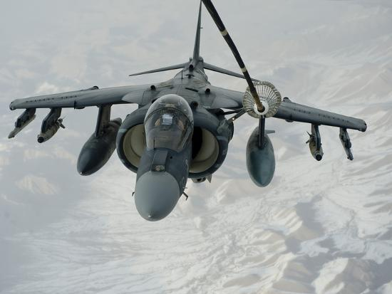 stocktrek-images-an-a-v-8b-harrier-receives-fuel-over-afghanistan-from-a-kc-10-extender
