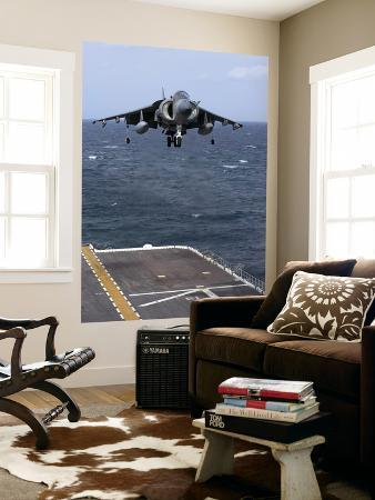 stocktrek-images-an-av-8b-harrier-ii-prepares-to-land-on-the-flight-deck-of-uss-nassau