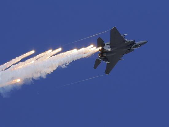 stocktrek-images-an-f-15e-strike-eagle-releases-flares
