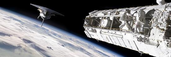 stocktrek-images-astronauts-work-on-a-space-station-while-a-space-shuttle-approaches
