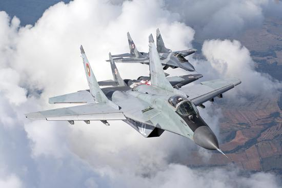 stocktrek-images-bulgarian-and-polish-air-force-mig-29s-planes-flying-over-bulgaria
