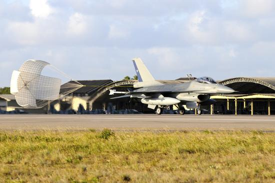 stocktrek-images-chilean-air-force-f-16a-landing-with-parachute-brake-at-natal-air-force-base