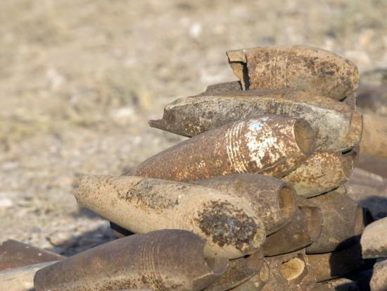 stocktrek-images-inert-artillery-shells-are-stacked-up-for-collection