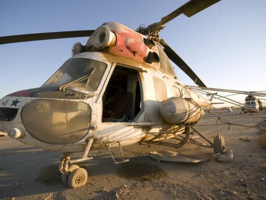 stocktrek-images-iraqi-helicopter-sits-on-the-flight-deck-abandoned-at-camp-warhorse