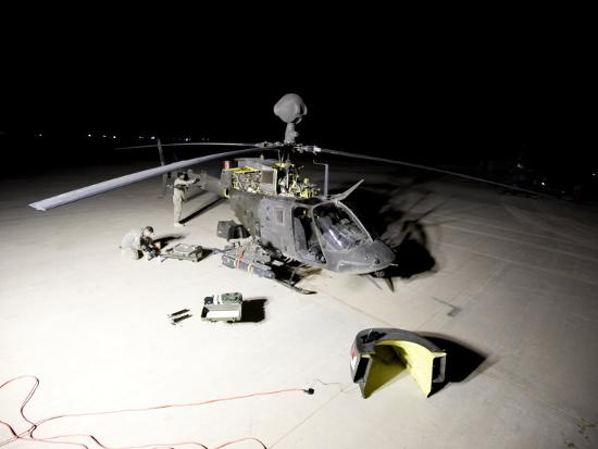 stocktrek-images-maintenance-crew-works-on-servicing-the-oh-58-kiowa-before-its-next-mission