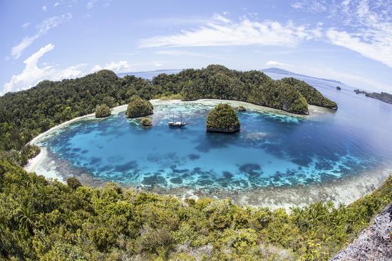stocktrek-images-rugged-limestone-islands-surround-a-lagoon-in-raja-ampat