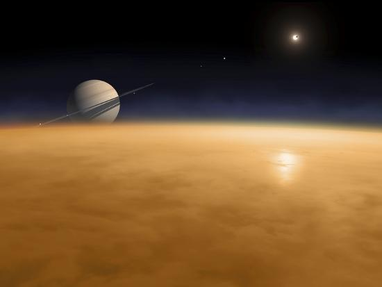 stocktrek-images-saturn-above-the-thick-atmosphere-of-its-moon-titan