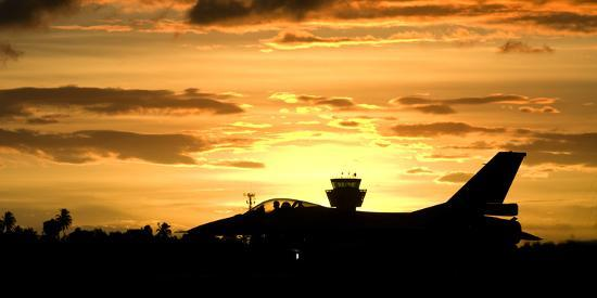 stocktrek-images-sunset-landing-this-chilean-air-force-f-16-fighting-falcon