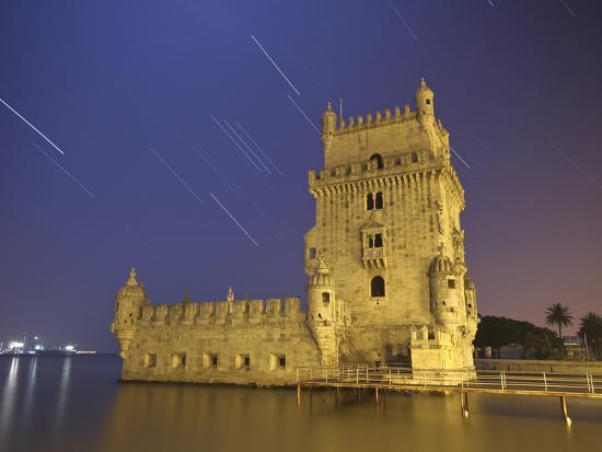 stocktrek-images-the-sirius-star-and-constellation-orion-setting-behind-the-belem-tower-in-lisbon-portugal