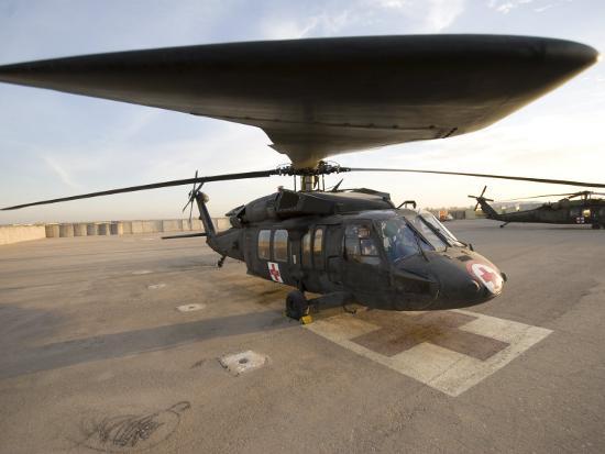 stocktrek-images-uh-60-blackhawk-medivac-helicopter-sits-on-the-flight-deck-at-camp-warhorse