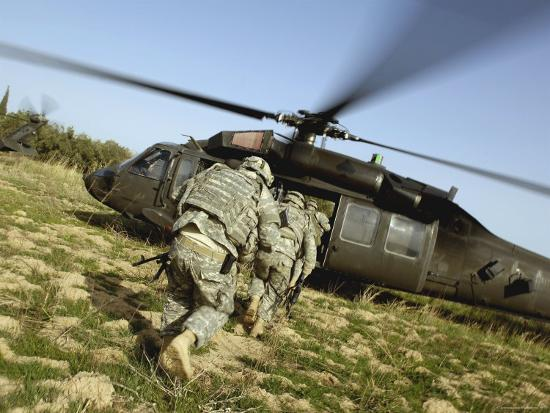 stocktrek-images-us-army-soldiers-prepare-to-board-a-uh-60-black-hawk-helicopter
