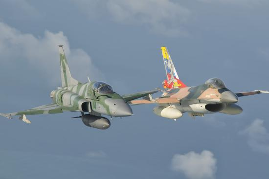 stocktrek-images-venezuelan-air-force-f-16-and-brazilian-air-force-f-5-in-flight-over-brazil