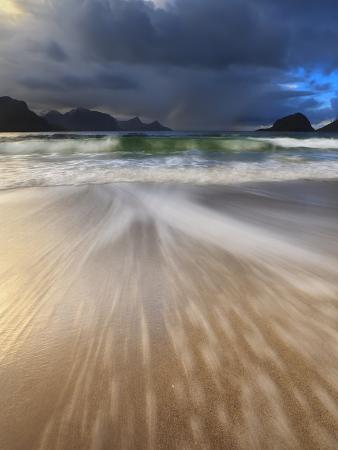 stocktrek-images-waves-washing-back-to-sea-on-haukland-beach-lofoten-norway
