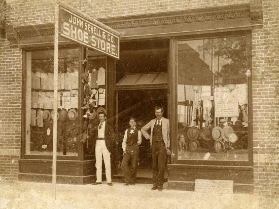 store-personnel-in-front-of-john-sewell-and-co-shoe-store-c-1910