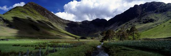 stream-flowing-through-a-landscape-haystacks-fleetwith-pike-lake-district-cumbria-england-uk