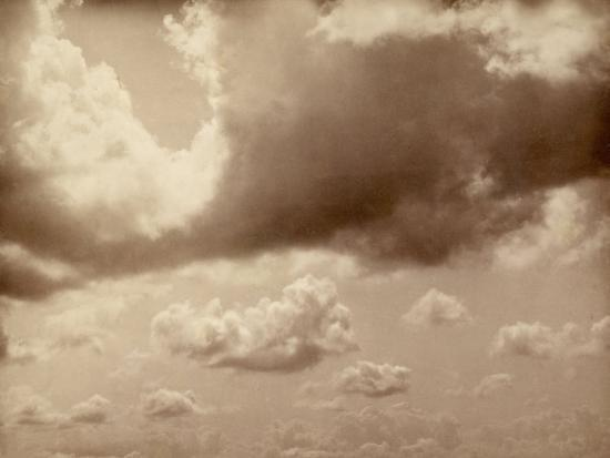 stretch-of-sky-with-large-clouds-the-silhouette-of-the-hills-can-be-made-out-below