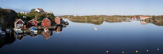 stuart-black-red-fishermen-s-huts-and-islands-in-archipelago-southwest-sweden