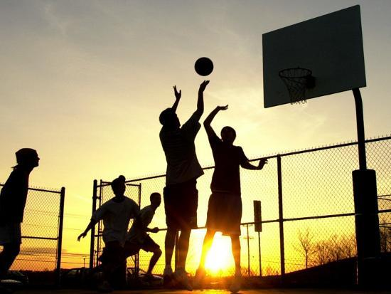 students-play-a-basketball-game-as-the-sun-sets-at-bucks-county-community-college