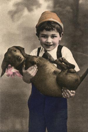 studio-portrait-little-boy-with-dachshund