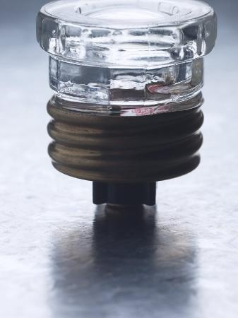 studio-shot-of-glass-electrical-fuse-on-metal-surface