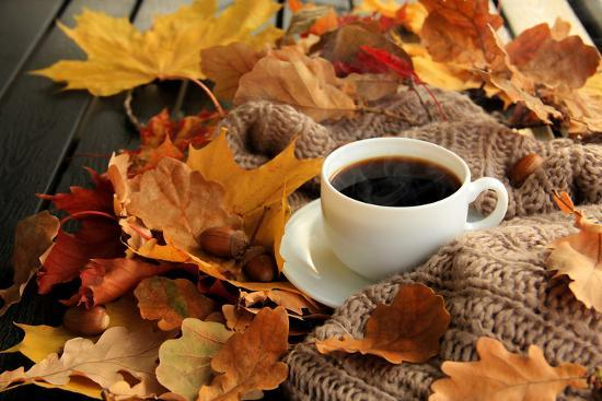 sunfe-autumn-fall-leaves-hot-steaming-cup-of-coffee-and-a-warm-scarf-on-wooden-table-background-season
