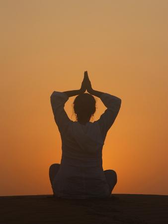 sunset-meditation-in-the-desert-abu-dhabi-united-arab-emirates-middle-east