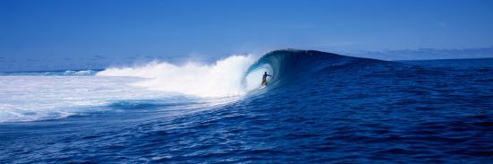 surfer-in-the-sea-tahiti-french-polynesia