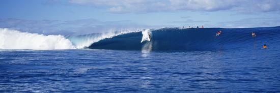surfers-in-the-sea-tahiti-french-polynesia