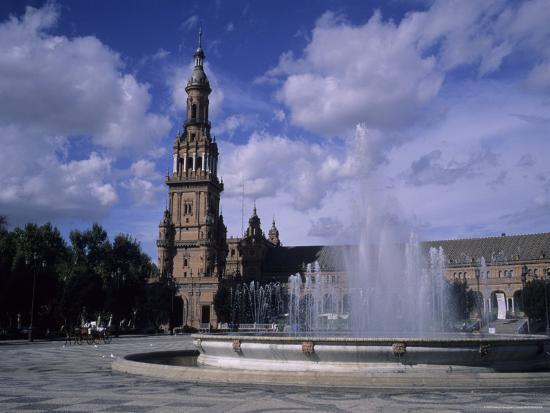 taylor-s-kennedy-the-fountains-of-the-plaza-de-espana-in-seville-on-a-summer-day-plaza-de-espana-seville-spain