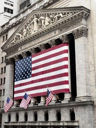 the-facade-of-the-new-york-stock-exchange-draped-in-the-american-flag