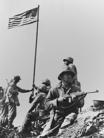 the-first-flag-raising-on-iwo-jima-s-mount-suribachi