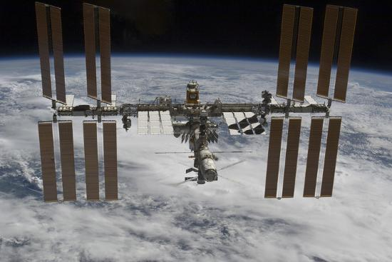 the-international-space-station-backdropped-against-clouds-over-earth